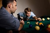 stock photo of snooker  - Young man focusing on playing snooker - JPG