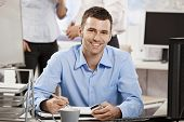 picture of work crew  - Casual young businessman working in office - JPG