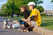 image of inline skating  - young heterosexual couple put on inline skates - JPG