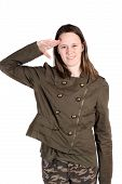 stock photo of army cadets  - Teenaged woman giving salute dressed in army like fatigues on a white background - JPG