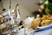 stock photo of devonshire  - devonshire cornish cream tea tea pot and scones - JPG