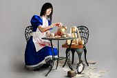 picture of alice wonderland  - Portrait of a young woman dressed as Alice in Wonderland - JPG