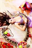 picture of concubine  - Shot of an oriental woman posing with a python - JPG