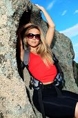 Young woman tourist posing at the mountains. poster