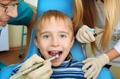 Shot of a little boy with dentists in a dental surgery. Healthcare, medicine.