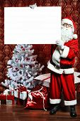 picture of santa claus hat  - Portrait of Santa Claus holding white board - JPG