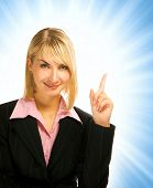 Beautiful business woman pointing her finger on abstract background
