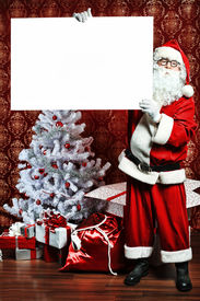 foto of santa claus hat  - Portrait of Santa Claus holding white board - JPG