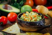 Guacamole With Corn Chips - Nachos, Made From Avocado, Tomatoes And Lime poster