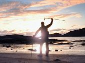 Man Hiker Backpacker Walking With Backpack On Sea Shore At Sunny Evening. Adventure, Tourism Active  poster