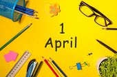 Fools Day - April 1st. Day 1 Of April Month, Calendar On Yellow School Desk Background. Spring Time. poster