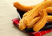 image of churros  - Churro or Spanish donut on a black dish - JPG