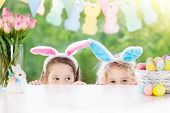 Kids With Bunny Ears And Eggs On Easter Egg Hunt. poster