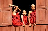 INLE LAKE, MYANMAR - FEBRUARY 02: Unidentified young monks look out of a monastery window on Februar