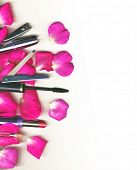 foto of makeup artist  - makeup brush and cosmetics with rose petals - JPG