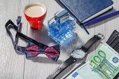 Man Perfume, Watch With A Black Leather Strap, Bow Tie, Notebook, Cup Of Coffee And Black Leather Wa poster