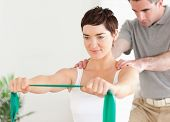 foto of physiotherapy  - Patient doing some special exercises under supervision in a room - JPG