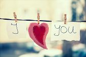 I Love You vintage background. Heart and note with words I Love You hanging on a clothesline poster