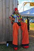 Man on stilts takes a break