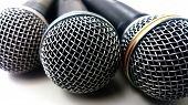 Three Microphone On White Background Or Microphone Isolated Use For Media Instrument Background poster