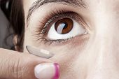 Woman Puts On A Contact Lens