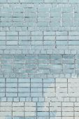 The Wall Of Bricks Is Pale Blue And Cornflower . Beautiful Background Of Smooth Masonry. Texture. poster