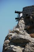 picture of trebuchet  - Old cannons mounted on the top of a castle wall and pointing out to sea - JPG