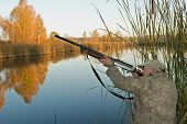 picture of duck-hunting  - The hunter on coast of wood lake