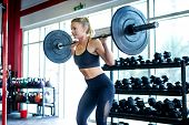 Muscular Athlete Training In A Crossfit Gym - Functional Training Workout In A Gym poster