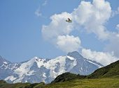 stock photo of hydroplanes  - Hydroplane over the chain of Mont Blanc in the French alps - JPG