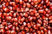 Sharp And Intense Color Close Up View Or Red, Wet, Juicy Pomegranate Seeds Background poster