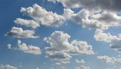 Fluffy Cumulus Clouds. Vast Blue Sky And Clouds Sky. Blue Sky Background With Tiny Clouds poster