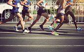 Marathon Runners Legs Running On City Road poster