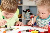 picture of little kids  - the two little children draw in earnest - JPG
