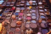 People Dying Hides At Colorful Tanning Pools At A Leather Tannery