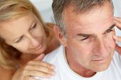 stock photo of close-up middle-aged woman  - Woman comforting anxious husband - JPG