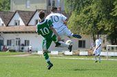 KAPOSVAR, HUNGARY - SEPTEMBER 5: Krisztian Garai (in white) in action at the Hungarian National Championship under 19 game Kaposvar (white) vs. Nagyatad (green) September 5, 2011 in Kaposvar, Hungary.
