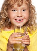 foto of drinking water  - Child with a glass of water isolated on white - JPG