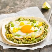 Breakfast Taco With Guacamole, Sunny Side Up Egg And Chili poster