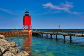Charlevoix Michigan on Lake Michigan is a beautiful vacation destination.  The Charlevoix South Pier poster