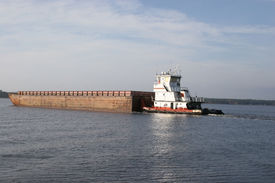 picture of coal barge  - coal barges being transported by a tug boat - JPG