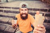 Snack For Good Mood. Guy Eating Hot Dog. Man Bearded Eat Tasty Sausage And Drink Paper Cup. Street F poster