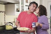 Senior Hispanic couple in kitchen
