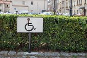 Black Handicapped Symbol Of Wheelchair On A Parking Lot, Sign Of Parking Space For Disabled Visitors poster