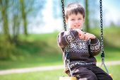 Small child on swing