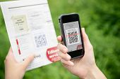 foto of barcode  - Scanning advertising with QR code on mobile smart phone - JPG