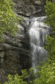 foto of spearfishing  - Waterfall against Rocks and Green Vegetation in Spearfish Canyon South Dakota - JPG