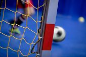Indoor Soccer Background. Futsal Junior Player On Indoor Training. Soccer Goal With Yellow Net. Socc poster