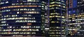 Glass Walls Of Modern Office Buildings With Many Large Panoramic Windows In Downtown Business Cluste poster