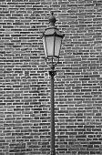 Monochrome street lamp and brick wall
